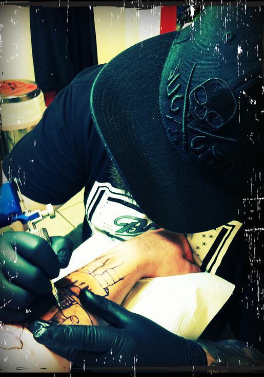aaron broke MI tattoo artist